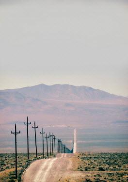 Jill Battaglia EMPTY ROAD IN DESERT WITH MOUNTAINS Desert