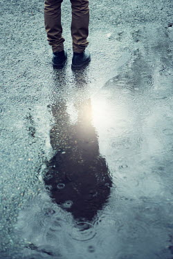Magdalena Russocka MAN REFLECTED IN PUDDLE IN RAIN Men