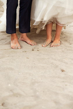 Maria Petkova BAREFOOT BRIDE AND GROOM STANDING ON BEACH Couples
