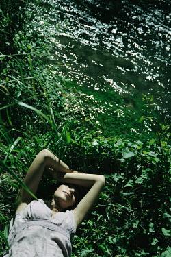 Giovan Battista D'Achille GIRL LYING IN FOLIAGE BY SUNLIT RIVER Women