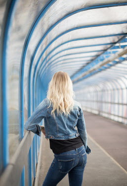 Holly Leedham BLONDE GIRL STANDING IN MODERN TUNNEL Women