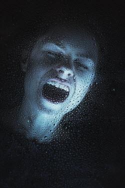 Magdalena Russocka WOMAN SCREAMING BEHIND WET WINDOW AT NIGHT Women