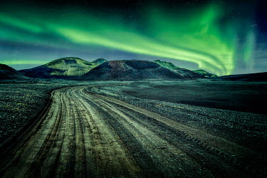 Evelina Kremsdorf ROAD IN ICELAND WITH NORTHERN LIGHTS Rocks/Mountains