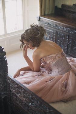 Holly Leedham SAD WOMAN IN PINK GOWN IN GRAND BEDROOM Women