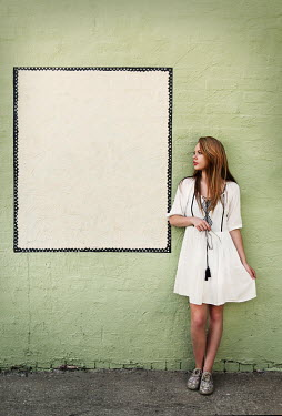 Buffy Cooper WOMAN STANDING BY WALL WITH WHITE SQUARE Women