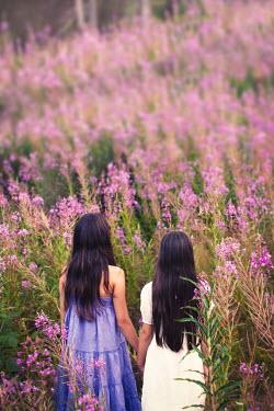Svetlana Bekyarova TWO GIRLS HOLDING HANDS IN FIELD OF PURPLE FLOWERS Children