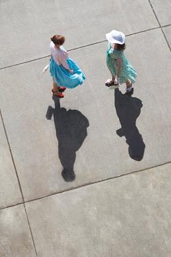 Susan Fox TWO RETRO WOMEN FROM ABOVE IN SUNLIGHT Women