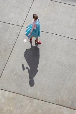 Susan Fox RETRO WOMAN WALKING ON SUNLIT PAVEMENT FROM ABOVE Women