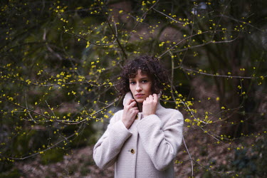 Anna Rakhvalova YOUNG WOMAN WITH CURLY HAIR BY WINTRY TREE Women