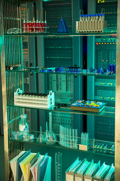 Colin Hutton SHELVES OF APPARATUS IN SCIENCE LABORATORY Interiors/Rooms