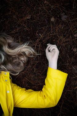 Laura Ranftler BLONDE WOMAN LYING ON GROUND Women