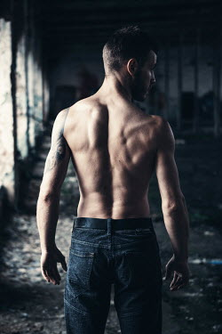 Magdalena Russocka MUSCULAR MAN WITH TATTOO IN OLD WAREHOUSE Men
