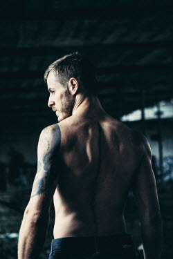 Magdalena Russocka TATTOOED MAN WITH BARECHEST IN OLD WAREHOUSE Men