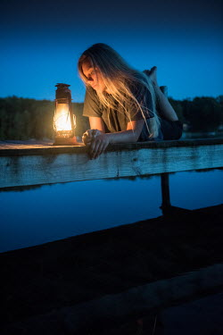 Terry Bidgood YOUNG WOMAN WITH LAMP BY LAKE AT NIGHT Women
