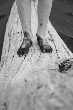 Colin Hutton MUDDY FEMALE FEET STANDING ON LOG BY LAKE Women