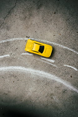 Jill Ferry YELLOW TOY CAR ON CHALK ROAD Miscellaneous Objects