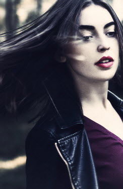 Magdalena Russocka BRUNETTE GIRL WITH FLOWING HAIR IN LEATHER JACKET Women