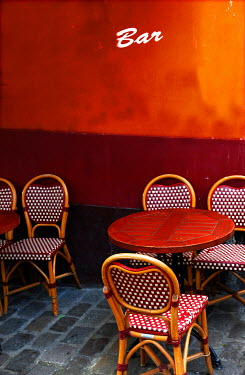 Ute Klaphake EMPTY BAR WITH RED TABLES AND CHAIRS Miscellaneous Buildings