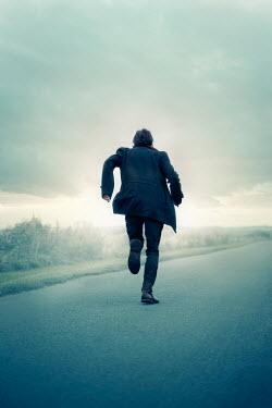 Laura Ranftler MAN RUNNING ON COUTRY ROAD IN WINTER Men