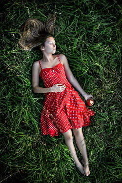 Stephen Carroll GIRL IN RED POLKA DRESS SLEEPING IN GRASS WITH APPLE Women