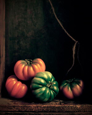 Allan Jenkins ORANGE AND GREEN SQUASHES IN WOODEN CUPBOARD Miscellaneous Objects