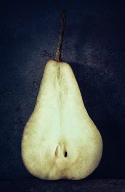 Amy Weiss CLOSE UP OF HALF A PEAR Miscellaneous Objects
