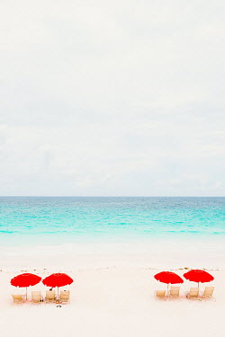 Claire Morgan COUPLE UNDER RED PARASOLS ON SANDY BEACH Seascapes/Beaches