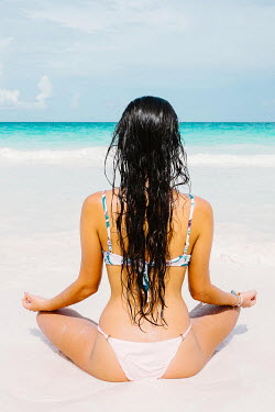 Claire Morgan WOMAN IN BIKINI MEDITATING ON BEACH Women