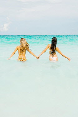 Claire Morgan TWO GIRLS IN BIKINIS HOLDING HANDS IN SEA Women