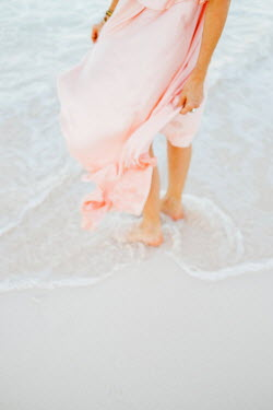 Claire Morgan WOMAN IN PINK DRESS PADDLING IN SEA Women