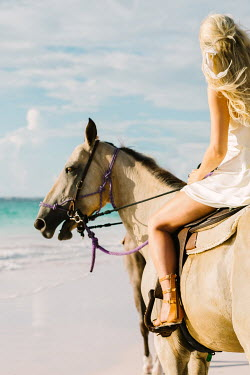 Claire Morgan BLONDE WOMAN RIDING HORSE ON SANDY BEACH Women