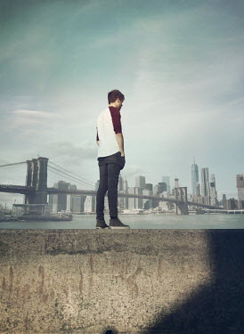 Mark Owen MAN STANDING ON WALL WITH NEW YORK SKYLINE Men