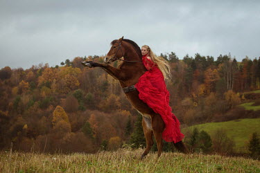 Anna Sychowicz WOMAN IN RED GOWN ON BROWN HORSE Women