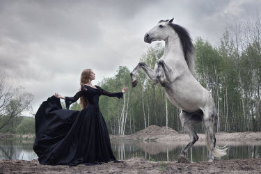 Anna Sychowicz MEDIEVAL WOMAN WITH GRAY HORSE BY LAKE Women