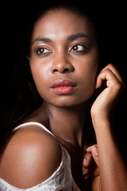 Clayton Bastiani CLOSE UP OF DAYDREAMING BLACK WOMAN Women