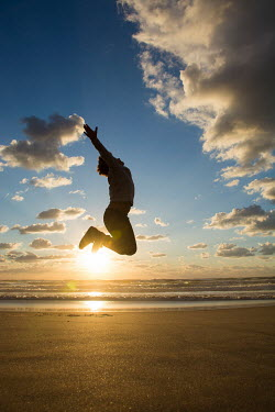 Mohamad Itani BOY JUMPING ON BEACH AT SUNSET Children