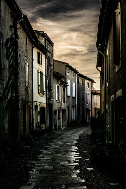 Elly De Vries EMPTY STREET IN HISTORICAL TOWN AT DUSK Streets/Alleys