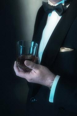 Ysbrand Cosijn ELEGANT MAN IN TUXEDO HOLDING DRINK Men