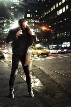 Nik Keevil MAN ON NEW YORK SIDEWALK IN WINTER Men