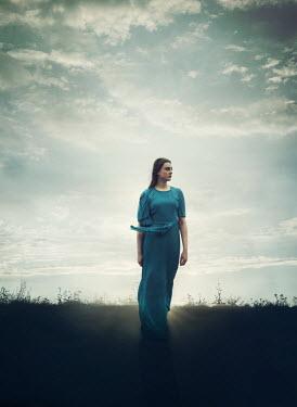Mark Owen WOMAN IN BLUE DRESS WALKING IN FIELD Women