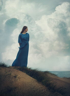 Mark Owen WOMAN IN BLUE DRESS ON SAND DUNES Women