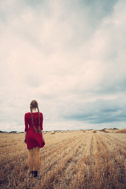 Magdalena Russocka GIRL IN RED DRESS STANDING IN WHEAT FIELD Women