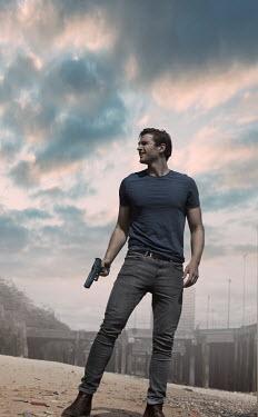 CollaborationJS MAN STANDING HOLDING GUN BY DOCKS Men