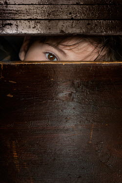 Galya Ivanova YOUNG BOY HIDING IN WOODEN BOX Children