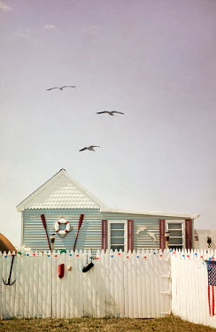 Miguel Sobreira BEACH HOUSE WITH PICKET FENCE IN SUMMER Houses