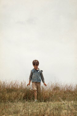 Miguel Sobreira HAPPY BOY WALKING IN FIELD Children