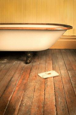 Jill Battaglia Vintage clawfoot bathtub with old letter. Interiors/Rooms