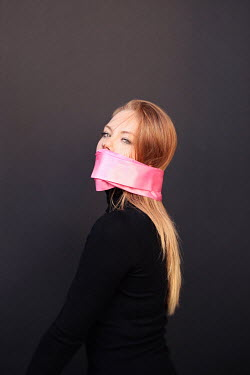 Buffy Cooper YOUNG WOMAN GAGGED WITH PINK RIBBON Women