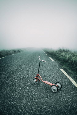 Magdalena Russocka CHILD'S SCOOTER ON FOGGY COUNTRY ROAD Miscellaneous Objects