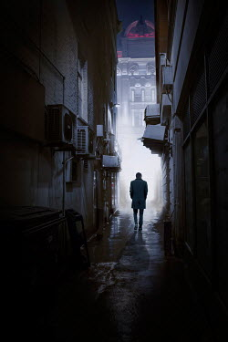 James Wragg MAN WALKING IN URBAN ALLEYWAY AT NIGHT Men